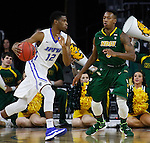 SIOUX FALLS, SD - MARCH 7:  Michael Calder #12 of Fort Wayne dribbles past Carlin Dupree #3 of North Dakota State in the 2016 Summit League Tournament.  (Photo by Dick Carlson/Inertia)