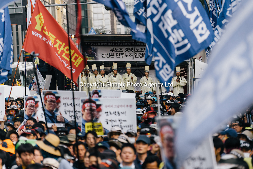 SEOUL - May, 2014 - Samsung Service Engineer Workers and Korea Metal Workers Union stage a protest holding the funerary portrait of Yeom Ho-seok, a Samsung engineer who had committed suicide. Yeom's body was forcefully taken away by police at his funeral.