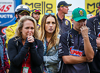 Nov 12, 2017; Pomona, CA, USA; Kim Anderson (left) and Cody Anderson , family of NHRA pro stock driver Greg Anderson (not pictured) react as they watch Bo Butner (not pictured) clinch the 2017 world championship during the Auto Club Finals at Auto Club Raceway at Pomona.  Mandatory Credit: Mark J. Rebilas-USA TODAY Sports