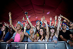 Fans dance to electronic musician Cashmere Cat's performance at Weekend 1 of the Coachella Valley Music and Arts Festival in Indio, California April 11, 2015. (Photo by Kendrick Brinson)
