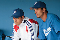 24 july 2010: Starting pitcher Joris Navarro of France is seen in the dugout next to Samuel Meurant prior to Netherlands 10-0 victory over France, in day 2 of the 2010 European Championship Seniors, in Neuenburg, Germany.