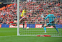 Callum O'Dowda of Oxford United scores the opening goal with a header past goalkeeper Adam Davies of Barnsley during the Johnstone's Paint Trophy Final match between Oxford United and Barnsley at Wembley Stadium, London, England on 3 April 2016. Photo by Alan  Stanford / PRiME Media Images.