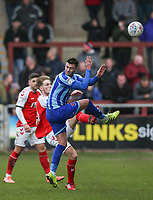 Fleetwood Town's Lewis Gibson hits a pass under pressure from Blackpool's Gary Madine <br /> Photographer Lee Parker/CameraSport<br /> <br /> The EFL Sky Bet League One - Fleetwood Town v Blackpool - Saturday 7th March 2020 - Highbury Stadium - Fleetwood<br /> <br /> World Copyright © 2020 CameraSport. All rights reserved. 43 Linden Ave. Countesthorpe. Leicester. England. LE8 5PG - Tel: +44 (0) 116 277 4147 - admin@camerasport.com - www.camerasport.com