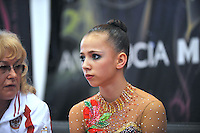 """Daria Dmitrieva of Russia is lectured by her coach at """"kiss & cry"""" during event finals at 2010 Grand Prix Marbella at San Pedro Alcantara, Spain on May 16, 2010. Daria placed 3rd AA at Marbella 2010. (Photo by Tom Theobald)."""