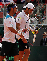 during their Davis Cup quarter-final doubles tennis match against xxx in Naples April 5, 2014.