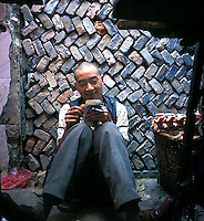 A man counts money on the street in Guangzhou, China.