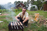 Korovikha, Ivanova Region, Russia, 04/08/2012..Pensioner Leonid Gorbach preparing pork shashlik in the garden of his home in the village of Korovikha, some 200 miles east of Moscow.