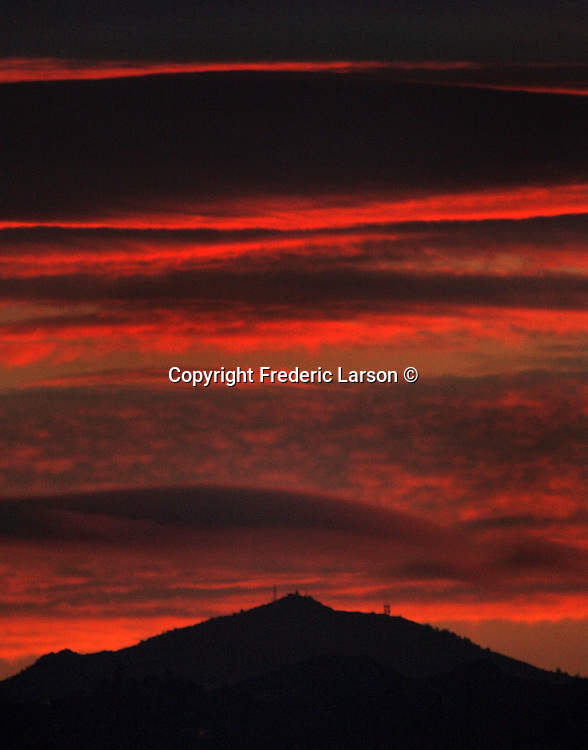 The sunrise lights up the skies over Mount Diablo in California.