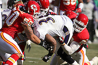 Ravens RB Jamal Lewis is tackled by Kawika Mitchell (50) and Jared Allen (69) in the second quarter against the Chiefs at Arrowhead Stadium in Kansas City, Missouri on December 10, 2006. Baltimore won 20-10.