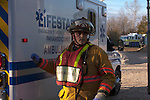 Slinger WI firefighter in charge of Operations in front of LifeStar Ambulance at a mass casualty incident