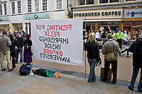 Police officers videoing a demonstration by the Members of the Speak Campaign the voice for the animals demonstrating in Cornmarket Oxford city centre for the release of Felix imprisoned inside Oxford University. They are collecting evidence that may be used to identify the demonstrators or may later be used in court..