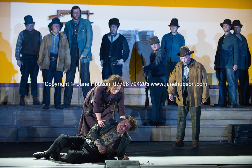 "London, UK. 30.09.2014. English National Opera's production of ""The Girl of the Golden West"", by Giacomo Puccini, directed by Richard Jones, conducted by Keri-Lynn Wilson, opens at London Coliseum. Picture shows: Susan Bullock (Minnie)  and Peter Auty (Dick Johnson). Photograph © Jane Hobson."