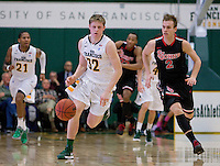 Tim Derksen of USF dribbles the ball during the game against St. John's at War Memorial Gym in San Francisco, California on December 4th, 2012.   USF Dons defeated St. John's, 81-65.