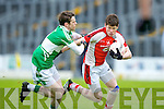 John Moynihan Rathmore is tracked by Legion's Andy O'Sullivan during their Club championship semi final in Fitzgerald Stadium on Saturday