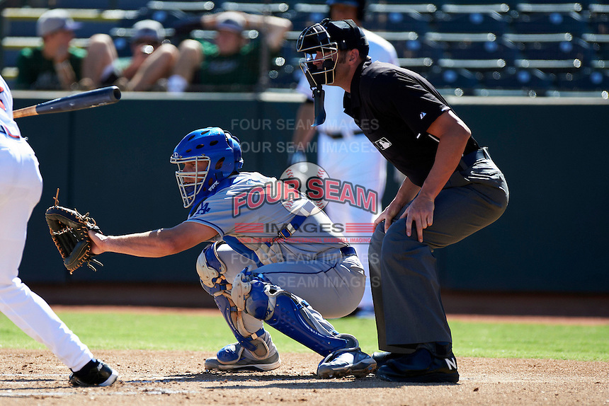 Mesa Solar Sox catcher Gorman Erickson #12, of the Los Angeles Dodgers organization, during an Arizona Fall League game against the Phoenix Desert Dogs at Phoenix Municipal Stadium on October 19, 2012 in Phoenix, Arizona.  Phoenix defeated Mesa 10-6.  (Mike Janes/Four Seam Images)