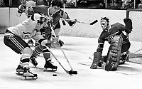 Seals vs. N.Y.Rangers: Serge Savard and goalie Phil Myre defend against the Seals Ted Hampson..Dec 11,1970 (photo by Ron Riesterer)