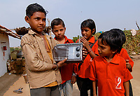 INDIA, Madhya Pradesh , children with radio in village