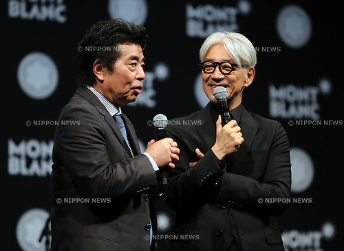 "December 21, 2016, Tokyo, Japan - Japanese composer Ryuichi Sakamoto, a member of the Yellow Magic Orchestra (YMO) is celebrated from his friend and a Japanese author Ryu Murakami (L) after he received Montblanc de la Culture Arts Patronage Award in Tokyo on Wednesday, December 21, 2016. Sakamoto played his screen music ""Merry Christmas Mr. Lawrence"" with young musicians.  (Photo by Yoshio Tsunoda/AFLO) LWX -ytd-"