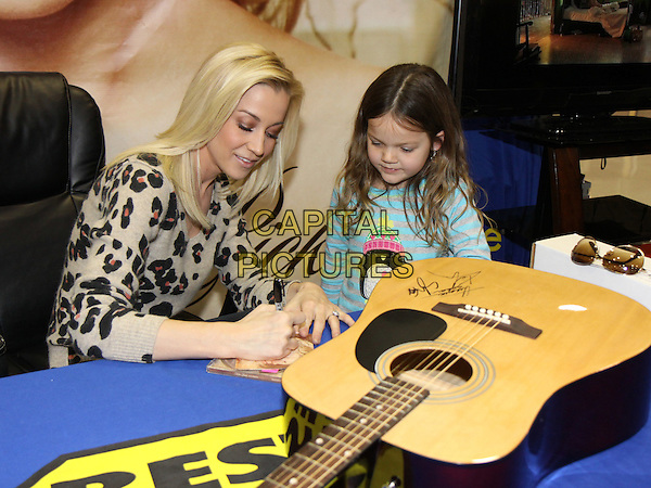 "Kellie Picker.Country artist Kellie Pickler made a stop at the Kennesaw, GA, Best Buy on her promotional tour for her new album ""100 Proof"".  There, Kellie met fans, signed autographs and posed for photos, Kennesaw, GA, USA, .January 28th, 2012..music half length leopard  print top  signing autograph young fan guitar .CAP/ADM/DH.©Dan Harr/AdMedia/Capital Pictures."