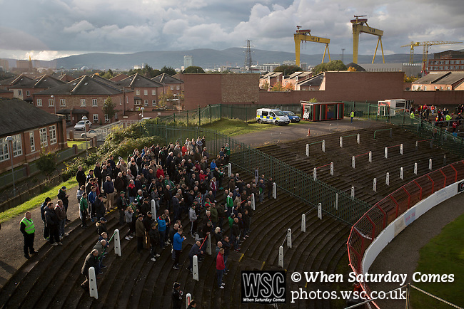 Glentoran 2 Cliftonville 1, 22/10/2016. The Oval, NIFL Premiership. Home supporters on the terracing watching the second-half action at The Oval, Belfast as Glentoran host city-rivals Cliftonville in an NIFL Premiership match. Glentoran, formed in 1892, have been based at The Oval since their formation and are historically one of Northern Ireland's 'big two' football clubs. They had an unprecendentally bad start to the 2016-17 league campaign, but came from behind to win this fixture 2-1, watched by a crowd of 1872. Photo by Colin McPherson.