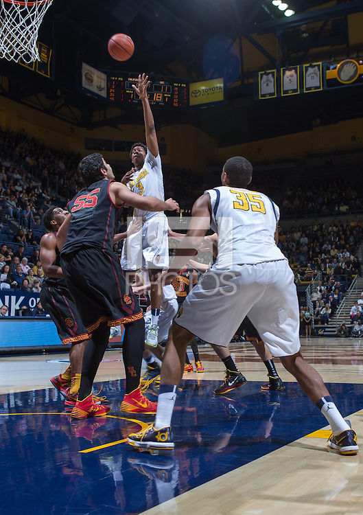 California's Jabari Bird shoots over USC's Omar Oraby for the basket during a game at Haas Pavilion in Berkeley, California on February 23th, 2014. California defeated USC 77 - 64