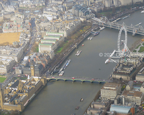 Aerial view of London from a commercial airliner on final approach into London Heathrow Airport showing Westminster Bridge, the Houses of Parliament, the London Eye, Hungerford Bridge, Elizabeth Tower, Big Ben, and the River Thames on Thursday, April 18, 2013..Credit: Ron Sachs / CNP