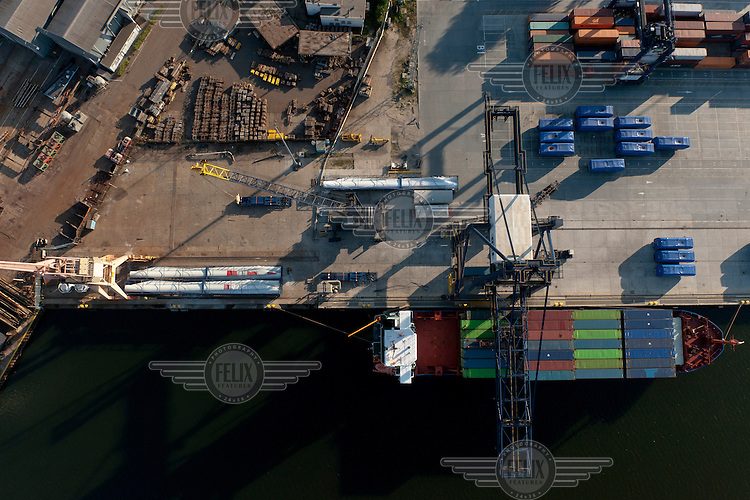 A cargo ship is unloaded at the harbour in Gdynia.