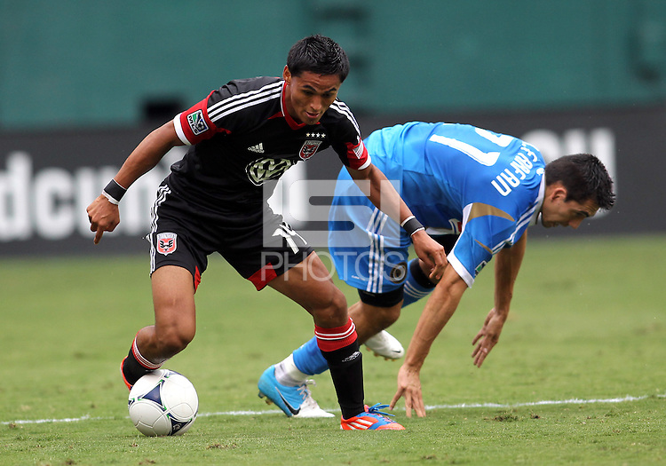 WASHINGTON, D.C. - AUGUST 19, 2012:  Andy Najar (14) of DC United moves the ball away from Michael Farfan (21) of the Philadelphia Union during an MLS match at RFK Stadium, in Washington DC, on August 19. The game ended in a 1-1 tie.
