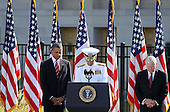 United States President Barack Obama, left, Chairman of the Joint Chiefs of Staff Admiral Mike Mullen, center, and Secretary of Defense Robert Gates, right, observe a moment of slience during an event to mark the anniversary of the 9/11 terrorist attacks at the Pentagon Memorial, Saturday, September 11, 2010 in Arlington, Virginia. Obama delivered remarks, laid a wreath, and greeted with victimsí families during the event on the 9th anniversary of the tragedy. .Credit: Alex Wong - Pool via CNP