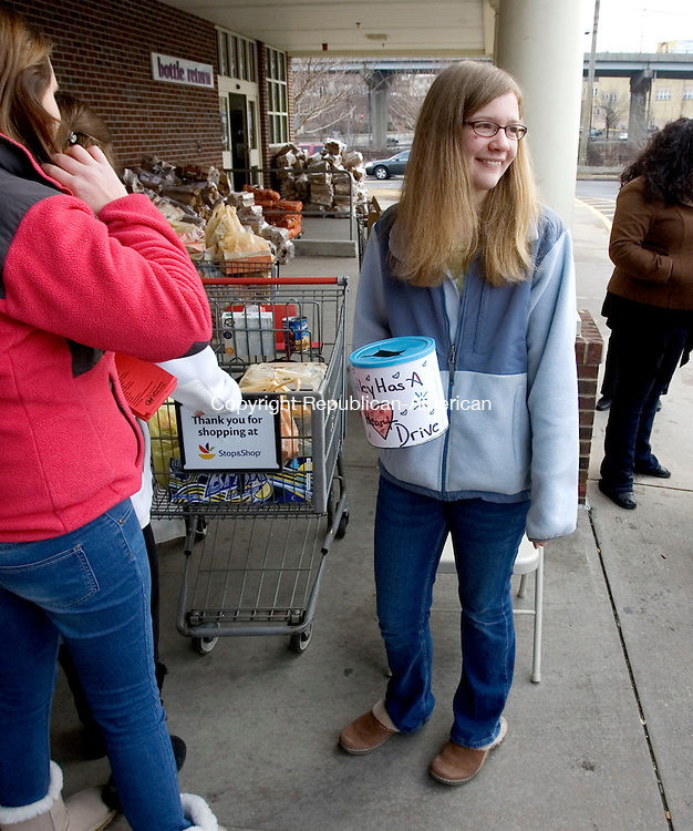 SEYMOUR, CT. 11 February 2012-021112SV02-Emily Discepola, 15, of the St. Joseph youth group in Seymour helps to collect food items for the Spooner House in Shelton at the Stop and Shop in Seymour Saturday. The Valley was having a Heart food drive Saturday at three Stop & Shop locations, including the one in Seymour, to benefit Spooner House in Shelton. It event helped fill the shelves at the Spooner House Food Bank..Steven Valenti Republican-American