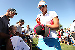 Lexi Thompson (right) signs some autographs for the fans before practicing at the 5th Annual Notah Begay III Foundation Challenge at Atunyote Golf Club in Vernon, New York on August 29, 2012