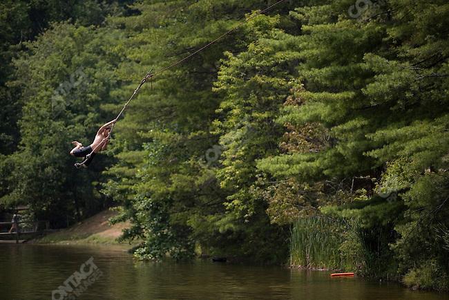 Campers jumping into the swimming hole at Falling Creek Boys Camp. Tuxedo, North Carolina, July 6, 2007