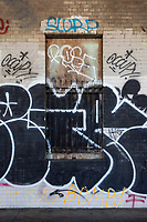 Graffiti covers a boarded up ticket window on the platform of the abandoned railway station on 16th St. in Oakland, California, that was built built in 1912 for the Southern Pacific Railroad and later used by Amtrak.