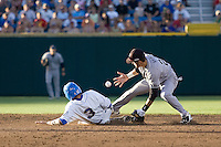 South Carolina SS Bobby Haney bobbles a ball as UCLA catcher Steve Rodriguez slides into second in Game One of the NCAA Division One Men's College World Series Finals on June 28th, 2010 at Johnny Rosenblatt Stadium in Omaha, Nebraska.  (Photo by Andrew Woolley / Four Seam Images)