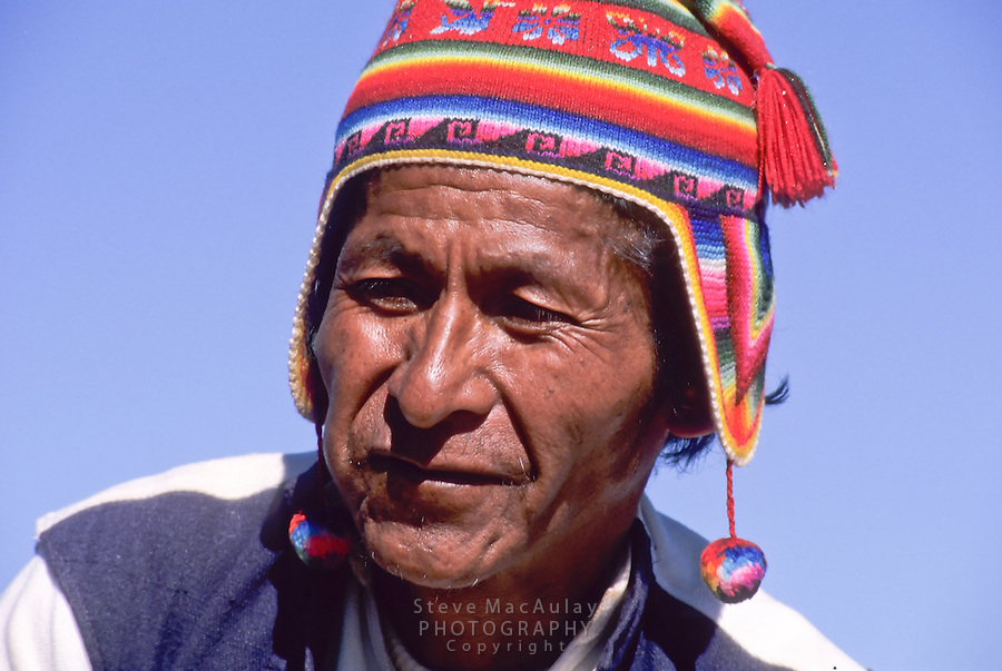 Old Peruvian man in traditional hat and tunic, Taquile Island, Lake Titicaca, Peru