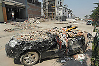 Cars crushed by the rubble of collapsed buildings in Dujiangyan, Sichuan, China..19 May 2008  .
