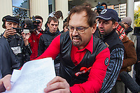 Moscow, Russia, 01/10/2012..Pro and anti Pussy Riot protesters scuffle outside Moscow City Court. Supporters and opponents of band members Maria Alyokhina, Yekaterina Samutsevich and Nadezhda Tolokonnikova demonstrated outside the court as the three appealed against their two-year jail sentence for their performance in the Christ The Saviour Cathedral. The appeal was postponed until October 10th after Samutsevich fired her lawyer.