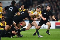 Bernard Foley of Australia takes on the New Zealand defence. Rugby World Cup Final between New Zealand and Australia on October 31, 2015 at Twickenham Stadium in London, England. Photo by: Patrick Khachfe / Onside Images