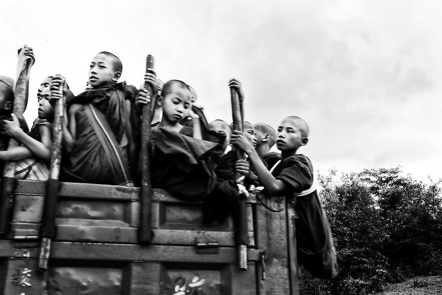 Novice monks travel along the old Burma highway from Muse near the China border in northern Shan State. Since late 2016, the area has seen heavy fighting after the Northern Alliance began a series of offensives in retaliation against offensives by the Burma army.