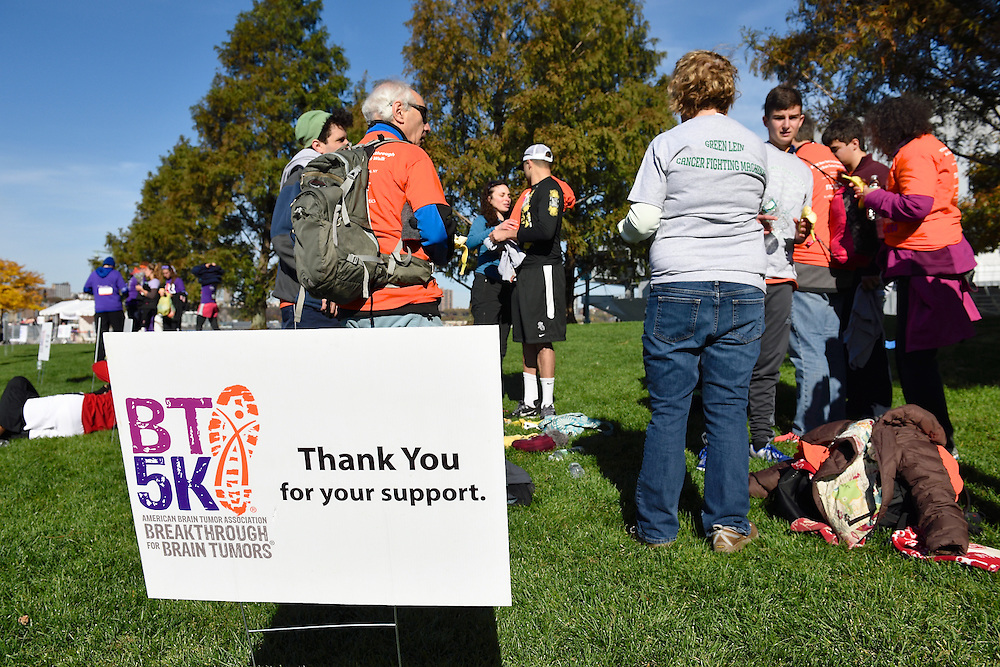 Thank you for your support sign with racers on the lawn in the background.