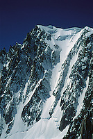 Cornices loom over couloirs on a satellite peak of the Mont Blanc Massif, between Courmayeur, Italy, and Chamonix, France.