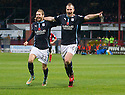 Dundee's David Clarkson (16) celebrates with Martin Boyle (23) after he scores.