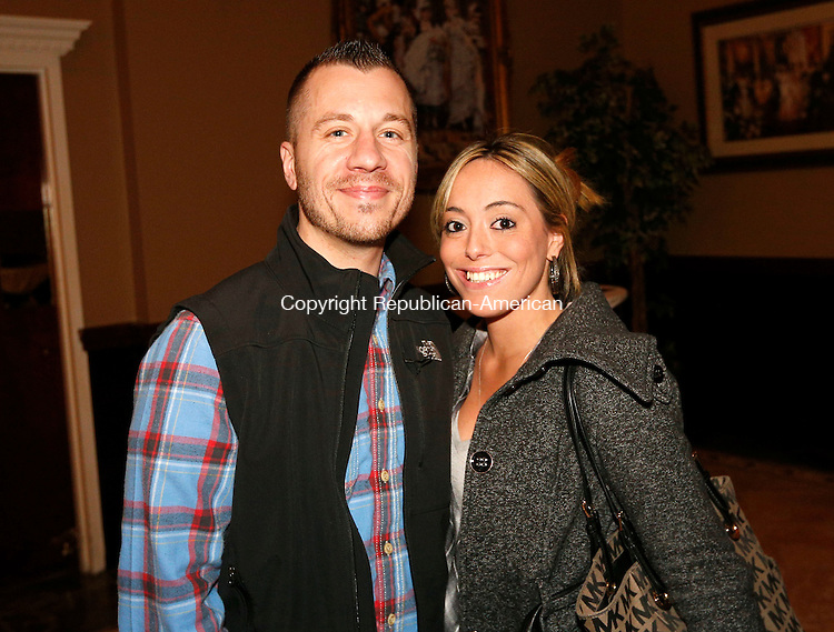 "Waterbury, CT- 09 April 2015-040915CM11-  Social moments--- From left, Jonathan Chabre of Terryville and Sabrina Grasso of Waterbury are photographed during The Eighth  Annual ""Wishes From Waterbury""  wine and beer tasting to benefit Make-A-Wish Foundation of Connecticut, at La Bella Vista, Ponte Club, in Waterbury on April 9th, 2015.  Christopher Massa Republican-American"