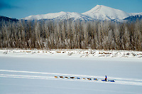 Mats Pettersson runs on the trail on the Yukon River 5 miles before the Kaltag checkpoint during the 2017 Iditarod on Sunday afternoon March 12, 2017.<br /> <br /> Photo by Jeff Schultz/SchultzPhoto.com  (C) 2017  ALL RIGHTS RESERVED