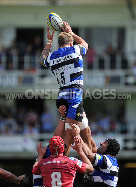 Dominic Day wins lineout ball for Bath. Pre-season friendly match, between Bath Rugby and the Scarlets on August 16, 2014 at the Recreation Ground in Bath, England. Photo by: Patrick Khachfe / Onside Images