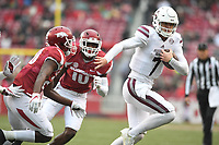 NWA Democrat-Gazette/J.T. WAMPLER Mississippi State's Nick Fitzgerald breaks away from a pair of Arkansas defenders Saturday Nov. 18, 2017 at Donald W. Reynolds Razorback Stadium in Fayetteville. Arkansas lost 21-28.