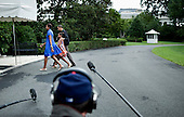United States President Barack Obama with daughter Sasha Obama and first lady Michelle Obama walks to the Residence from Marine One on the South Lawn of the White House, Sunday, August 15, 2010 in Washington, DC.  President Obama was returning from the Gulf Coast where he stayed in Panama City Beach, Florida with first lady Michelle Obama and their daughter Sasha for an overnight trip to the region which has been affected by the BP oil spill from the sinking of the Deep Water Horizon drilling platform. .Credit: Brendan Smialowski - Pool via CNP