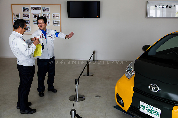 Toyota city, July 16 2014 - Managers of Toyota Motor Company discussing in the showroom.