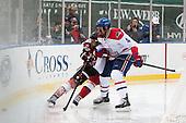 Adam Reid (NU - 8), Joe Houk (UML - 4) - The Northeastern University Huskies defeated the University of Massachusetts Lowell River Hawks 4-1 (EN) on Saturday, January 11, 2014, at Fenway Park in Boston, Massachusetts.