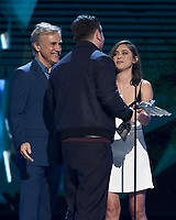 """LOS ANGELES - DECEMBER 6: Roger Clark (C) accepts the Best Performance award for """"Red Dead Redemption 2"""" from Christoph Waltz and Rosa Salazar at the 2018 Game Awards at the Microsoft Theater on December 6, 2018 in Los Angeles, California. (Photo by Frank Micelotta/PictureGroup)"""